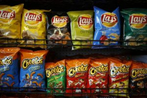Frito-Lay snacks are displayed for sale inside a Royal Dutch Shell Plc gas station in Louisville, Kentucky, U.S., on Monday, April 13, 2015. PepsiCo Inc., whose stable of brands includes beverages and the Frito-Lay snack division, is scheduled to release first-quarter earnings results on April 23. Photographer: Luke Sharrett/Bloomberg via Getty Images